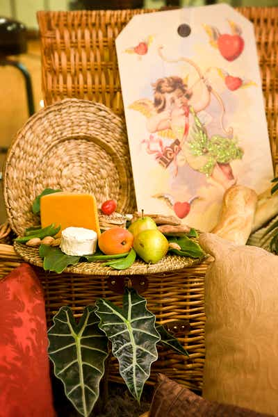 picnic gift basket with delicious cheese and fruits