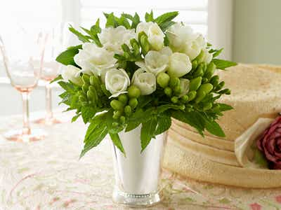 Mind and White tulips as beautiful centerpiece