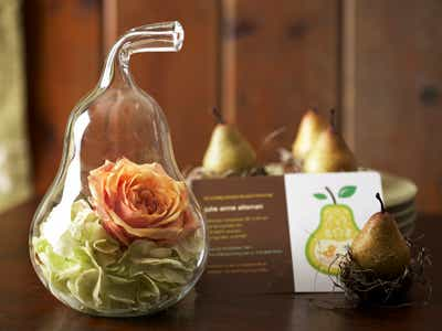 Rose and flowers inside glass pear invite