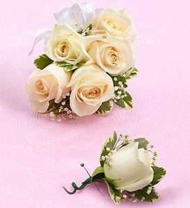 Order white corsage and boutonniere from 1800flowers.com!