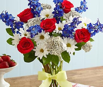 red, white and blue flowers with yellow ribbon