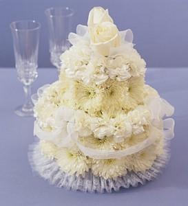 Send a floral wedding cake.