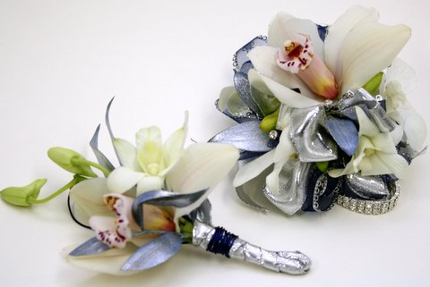 orchid prom corsage and boutonniere