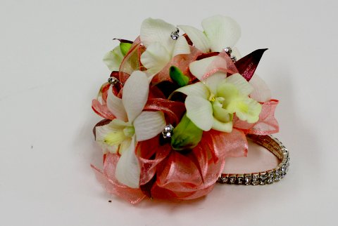 white orchid prom corsage with coral ribbons