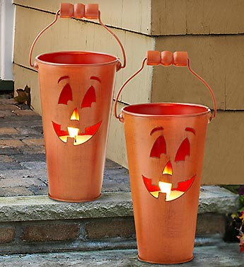 Two outdoor Jack O Lantern pumpkin candles from 1800flowers!