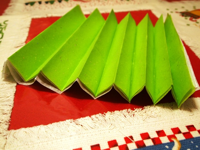 Stack of Christmas Tissue Paper Folded Like an Accordion