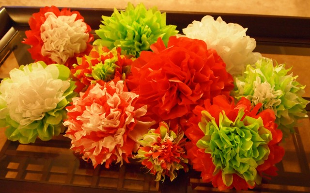 How to make tissue paper flower ornaments for christmas petal talk stacked piles of christmas tissue paper tissue paper flower ornaments in a variety of color patterns mightylinksfo