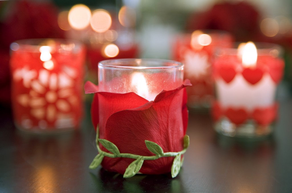 Romantic candles with rose petals