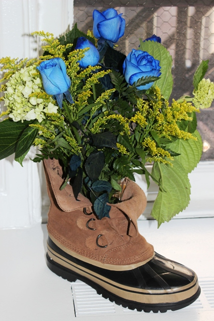 Flowers and Vase Placed in a Construction Boot to Make a Father's Day Construction Boot Bouquet