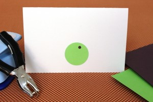 Green and Black Hole Punches Glued on Cardstock to Make Putting Green for Golf Father's Day Card