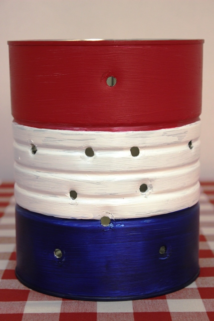 Holes Punched Into a Painted Coffee Can to Make a 4th of July Luminary Vase