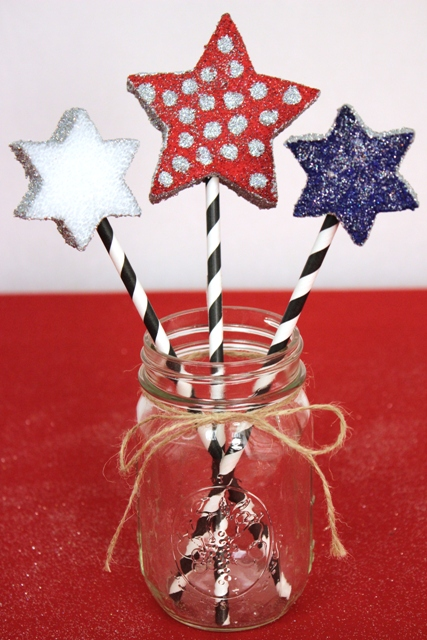 Styrofoam Stars Decorated With Glitter and Attached to Striped Straw Handles