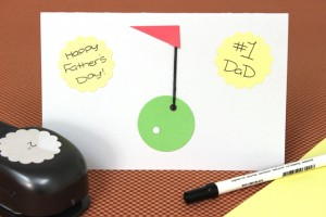 Yellow Hole Punches Used to Write Personal Message on Golf Father's Day Card