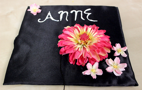 how-to-decorate-graduation-cap-with-flowers_glue-complete