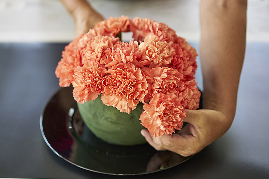 Cover the rest of the floral foam sphere with flowers