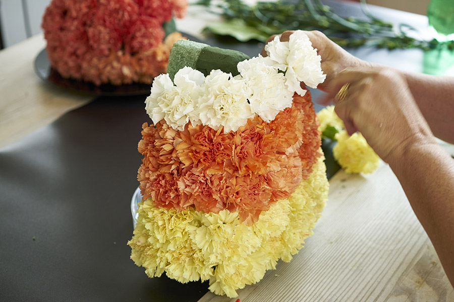 White Carnations Candy Corn Arrangement