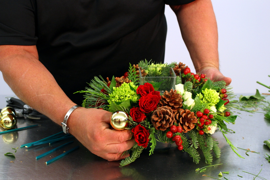 Add ornaments to Christmas centerpiece