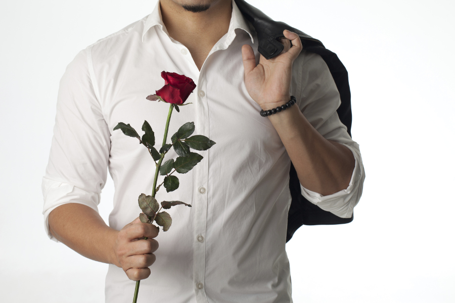 man-bringing-rose-to-woman-at-work