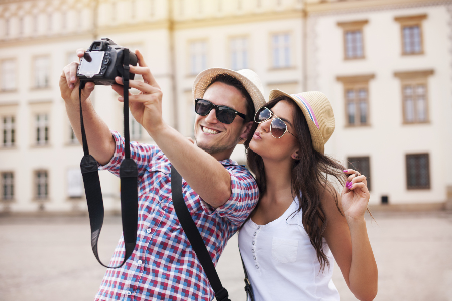 Couple taking a selfie as tourists