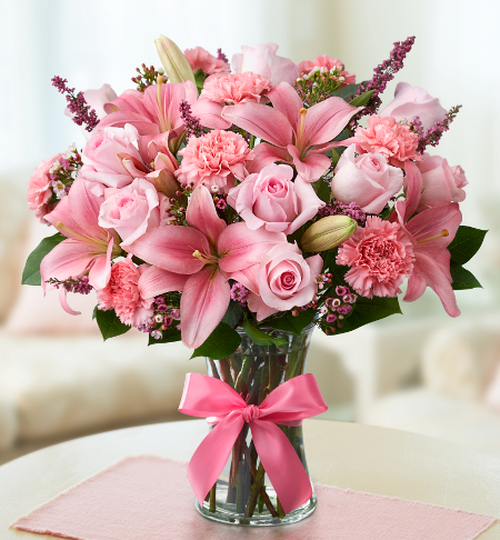 Pink flower bouquet with pink lilies, pink roses, pink carnations and more.