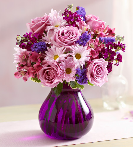 Bouquet of lavender roses, lavender daisies, purple statice and other purple flowers