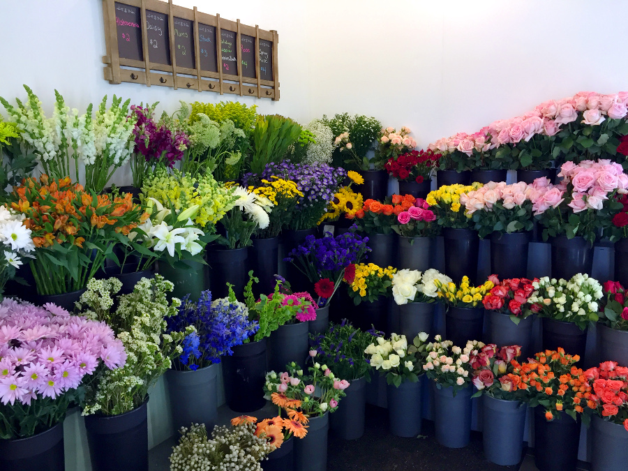 Buckets of flowers in 1800flowers shop