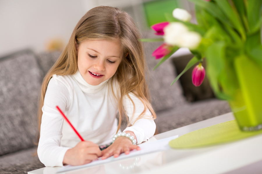 Beautiful happy little girl coloring for Mother's Day