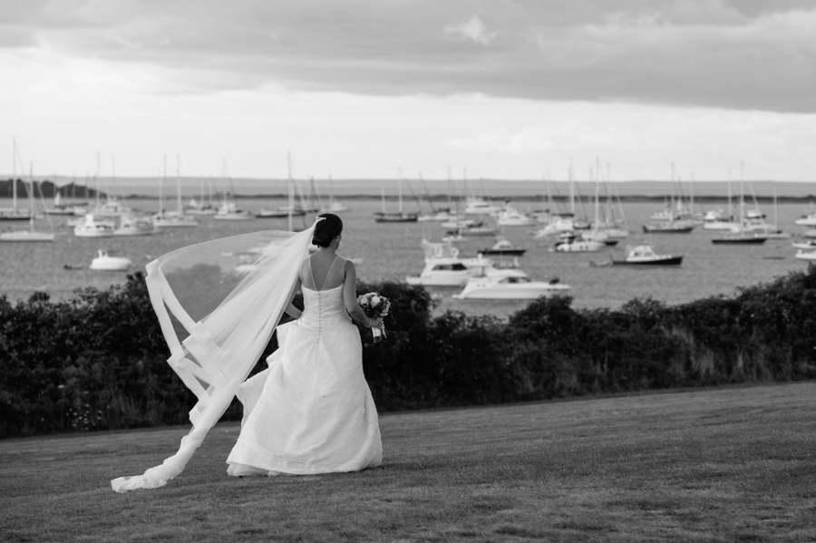 bride-overlooking-bay-with-boats