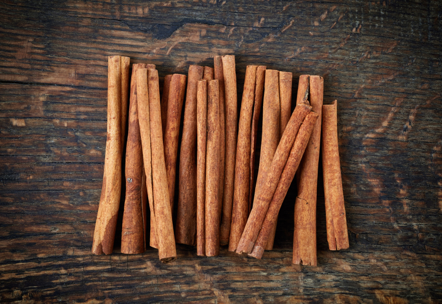 cinnamon sticks on wooden table