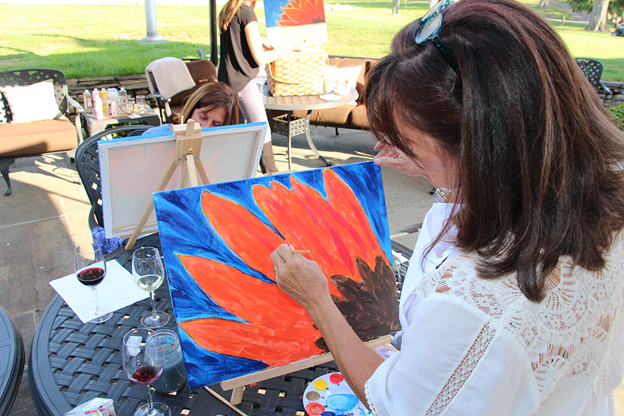woman-painting-sunflower