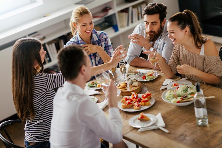 Friends Around Dinner Table for Friendsgiving