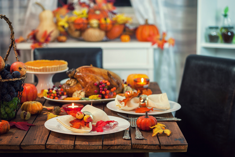 Decorated Thanksgiving Dinner Table with Turkey