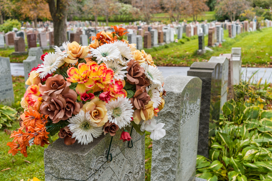 cemetery-flowers-on-tombstone