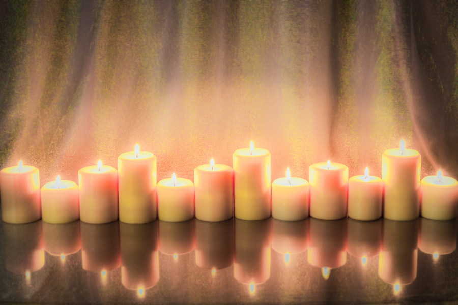 Lit Gold Pillar Candles