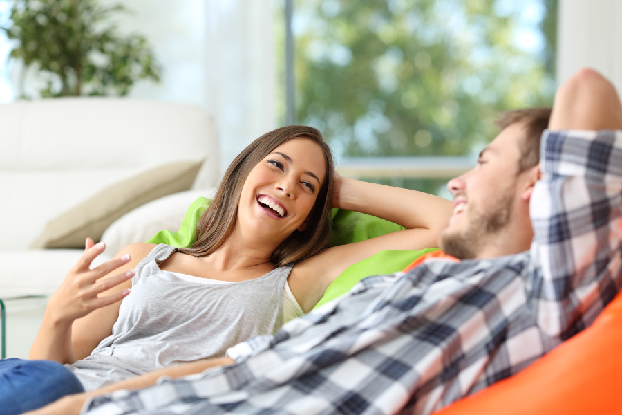 Couple sitting at home and laughing together