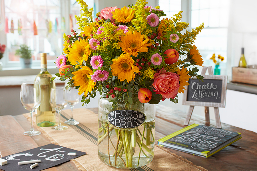 Flower Arrangement with Chalkboard Lettering Label Hoes over Bros