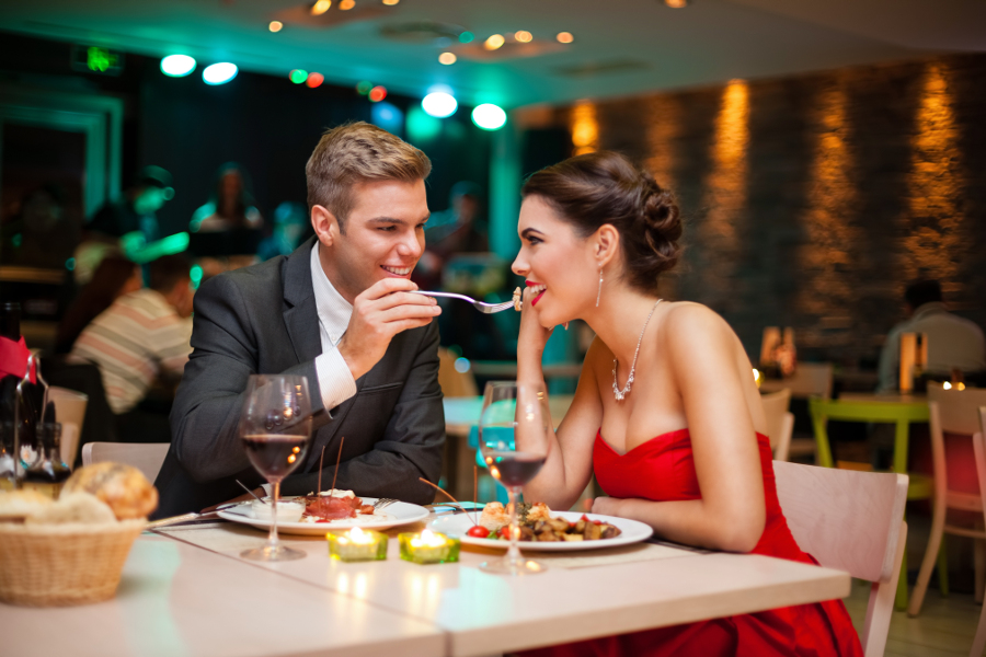 Couple Dining at Fancy Restaurant