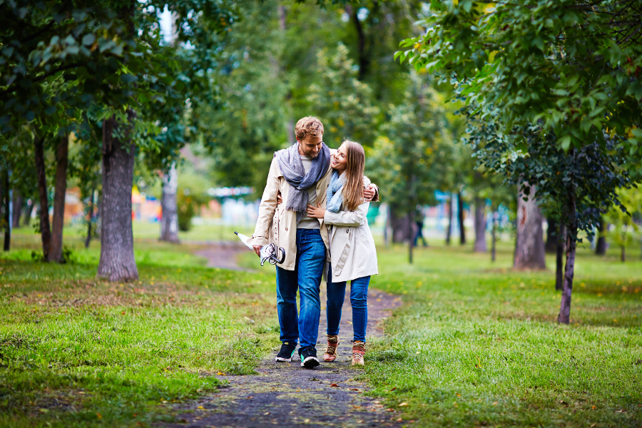 Couple walking through the park