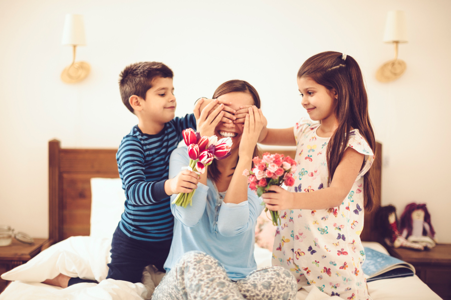 Kids surprising mom with flowers