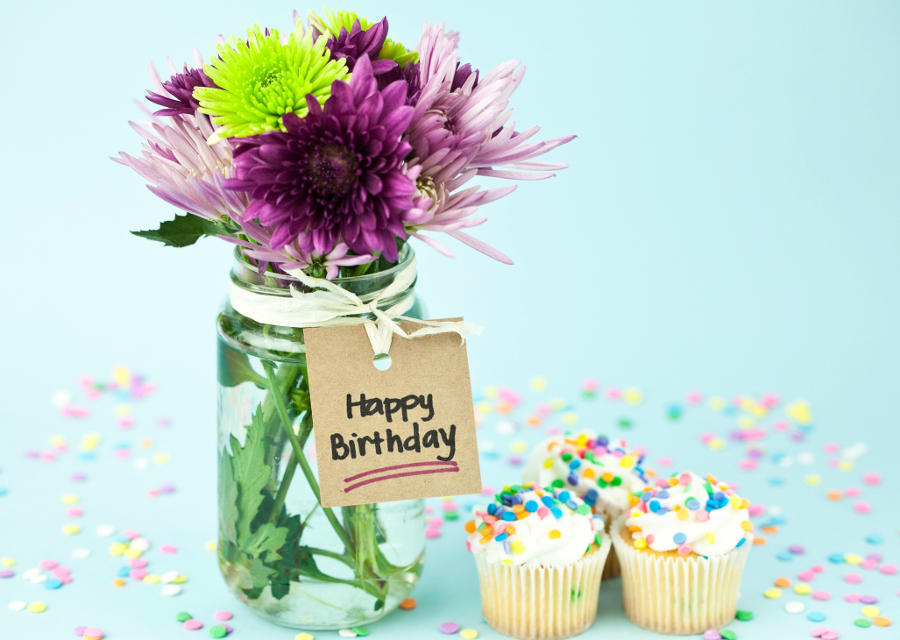happy birthday flowers in mason jar with cupcakes
