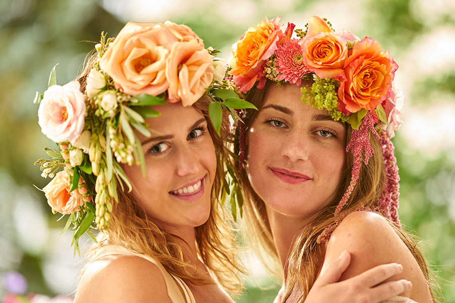 Two Young Women Wearing Flower Crowns