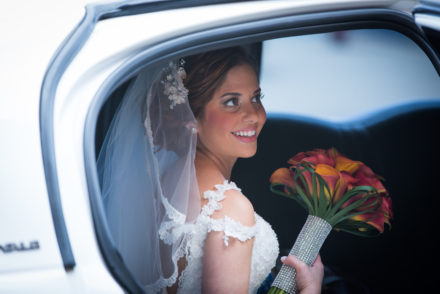 Bride with bouquet in car