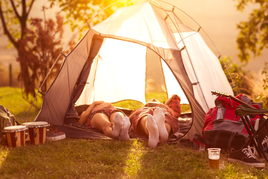 couple laying in tent camping