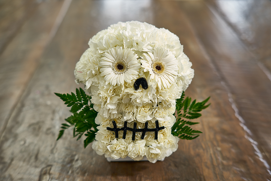 flower sugar skull on wooden table