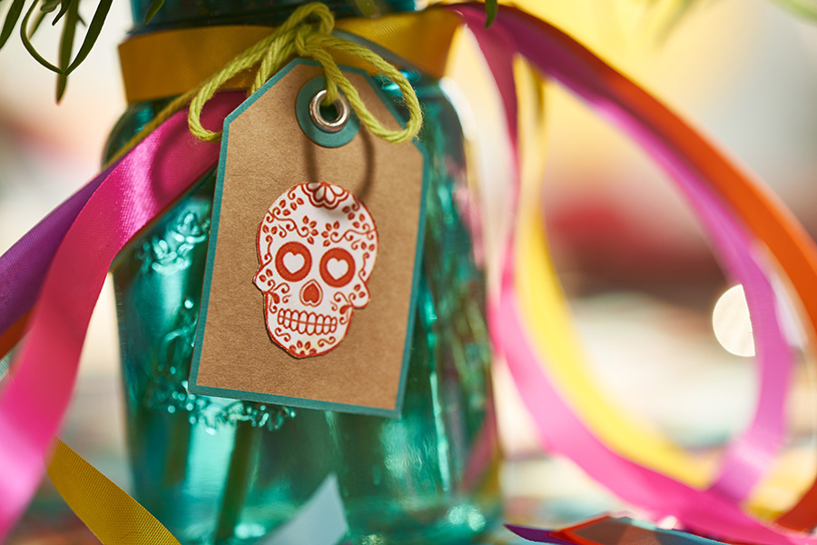 day of the dead marigolds in centerpiece sugar skull tag