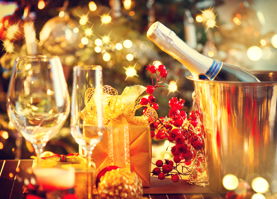 champagne bottle and glasses on table holiday guide