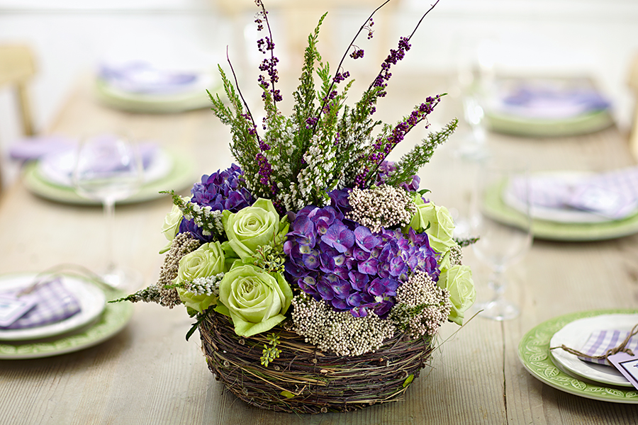 Oversized floral centerpiece with hydrangeas, rice flowers, waxflowers, roses, and solidago
