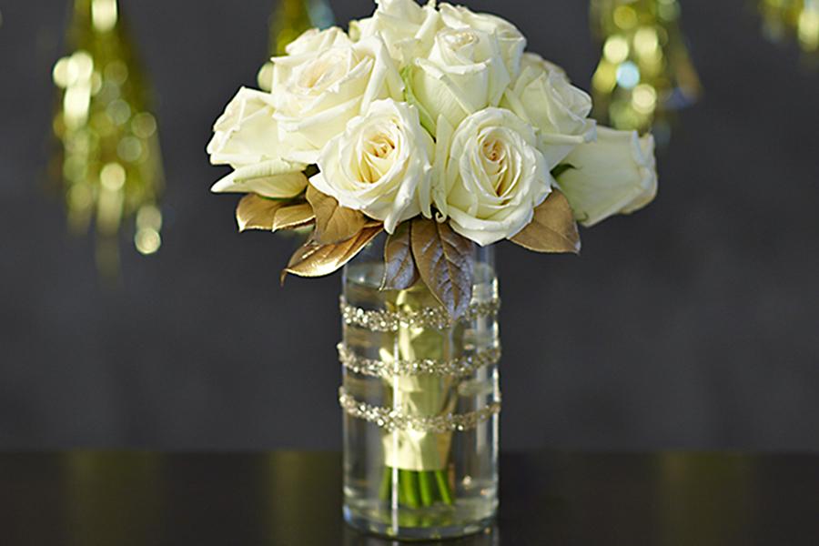 white roses in glitter vase
