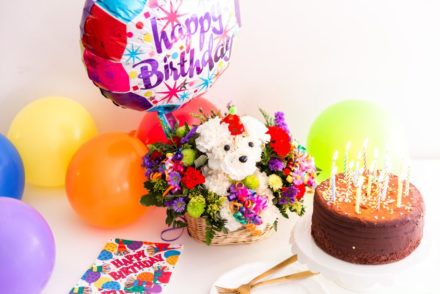 Birthday cake, flowers, and balloons