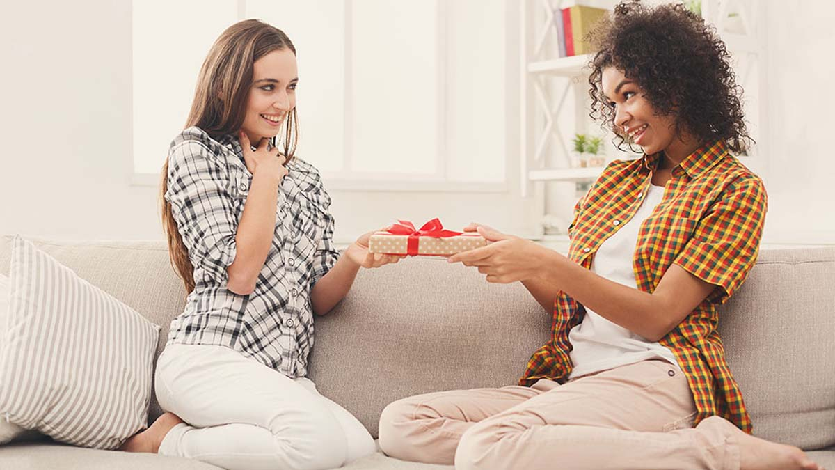 Excited woman getting gift from her friend